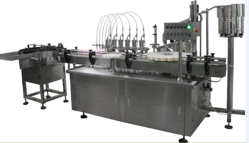 liquid filling and capping machine with feeding table
